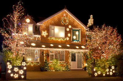 A cozy house lit up with beautiful Christmas lights.
